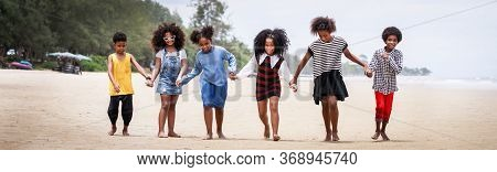 Funny Vacation. Children Or Kids Playing And Romp Together At The Beach On Holiday. Having Fun After