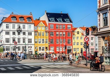 Copenhagen, Denmark - July, 2019: Copenhagen Iconic View. Famous Old Nyhavn Port With Colorful Medie