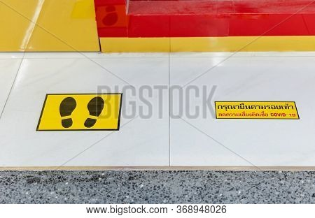 Footprint Sign For Stand In The Shopping Mall. The Thai Text Means,