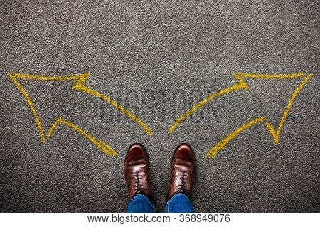 Decision In Life Or Business Concept. Separates The Left And Right By Two Arrow Direction. Top View
