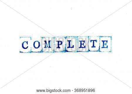 Blue Ink Of Rubber Stamp In Word Complete On White Paper Background