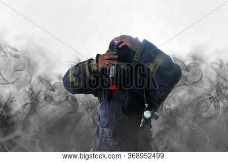 Firefighter In Uniform In Protective Breathing Mask On His Head With Inscription No Problem On Smoke