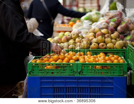 Homemaker In A Fruits Stand