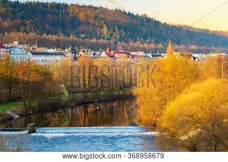 Houses In The City Of Karlovy Vary On The Tepla River During Sunrise In Spring. Karlovy Vary Carlsba