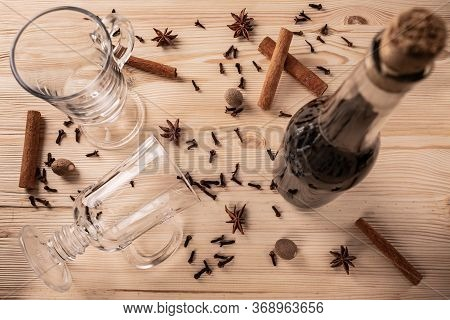 Differential Focus. Limpid Glasses For Mulled Wine, Cork Bottle With Red Wine, Cloves, Anise Flowers