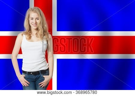 Iceland Concept. Happy Woman With The Icelandic Flag Background. Travel And Learn Icelandic Language