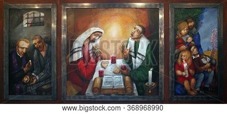 PARIS, FRANCE - OCTOBER 15, 2014: Supper at Emmaus by Sieger Koder, altar in Church of St. Albert the Great in Paris, France
