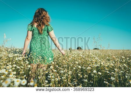 Blonde Woman With Blue Eyes Enjoying Freedom In The Country
