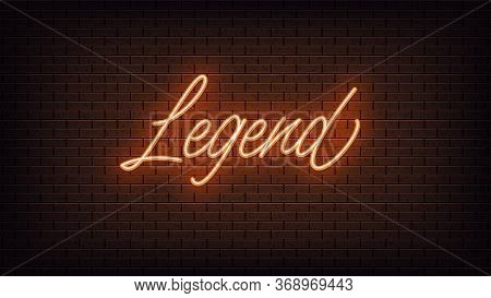 Orange Neon Legend, Lettering. Neon Text Of Legend On Black Brick Background. Night Vivid Lights. Wo