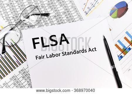 Text Flsa Fair Labor Standards Act Written On The Sheet. Pen, Glasses, Documents, Graphics.