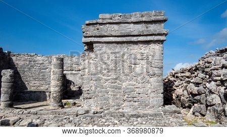 Side View Of Old Stone Ruins Situated In The Ancient Mayan City Of Tulum In Quintana Roo, Mexico.