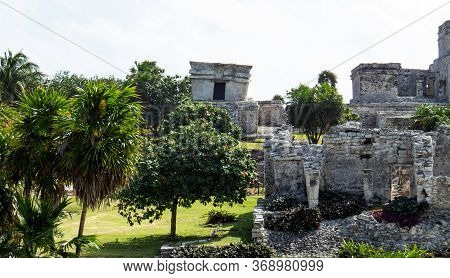 Temples In The Tropical Nature Situated In The Ancient Mayan City Of Tulum In Quintana Roo, Mexico.