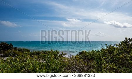 Beautiful View Of The Ocean And Nature From The Ancient Mayan City Of Tulum In Quintana Roo, Mexico.