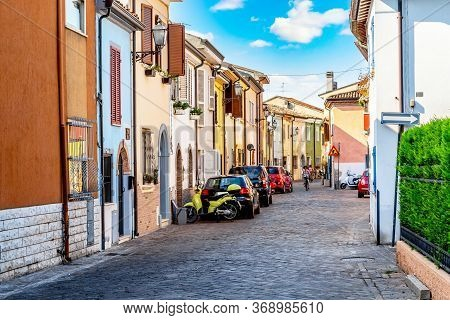 Narrow Street Of The Village Of Fishermen San Giuliano With Colorful Houses, Cars And A Bicycles Dur