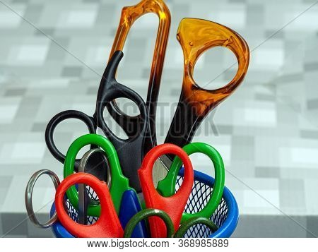 A Set Of Scissors Of Different Sizes In The Stand. Scissors For Different Works, For Children And Ad