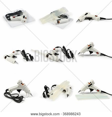 Nine Electric Hot Glue Gun Isolated On White Background. High Resolution Photo. With Clipping Path.