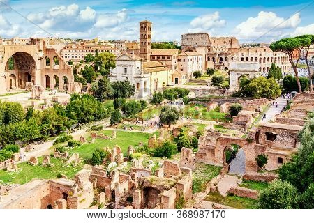 Aerial Panoramic Cityscape View Of The Roman Forum And Roman Colosseum In Rome, Italy. World Famous