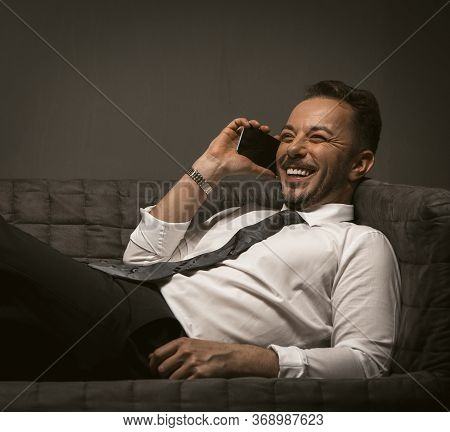 Happy Businessman Smiles Talking On Mobile Phone. Young Caucasian Man In Formalwear Has Communicatio