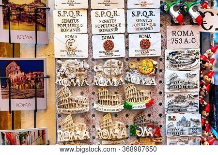 Rome, Italy - October, 2019: Many Magnets Tourist Souvenirs On The Shop Window In Rome, Italy. Magne