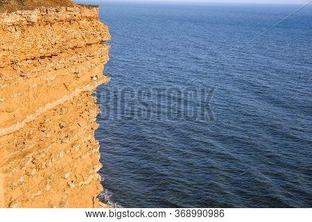 Jurassic Coast Cliff With Seagull Bird Over The Ocean In Bridport, Dorset, Uk