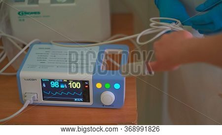 Pulse Oximeter At Work. Medical Diagnostic Equipment. Patients Hand With Attached Pulse Oximeter Sen