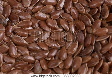 Flax Seeds Pouring End Rotating In Slow Motion. Flax Seeds