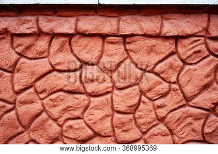 Decorative Imitation Of A Pebble Stone Wall Background Texture. The Cement Plaster Of The Wall Is De