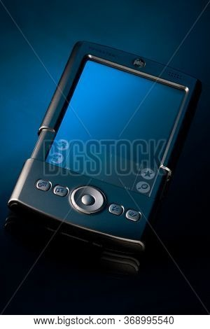 Belgorod , Russia - NOV, 04, 2008: Old style Palm PDA smartphone on isolated blue background.