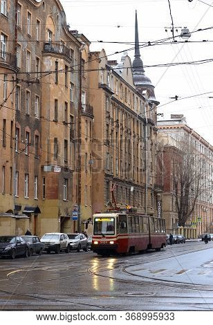 St. Petersburg, Russia - January 6, 2020: Tram Rides On Winter Street Of Saint Petersburg. Backgroun