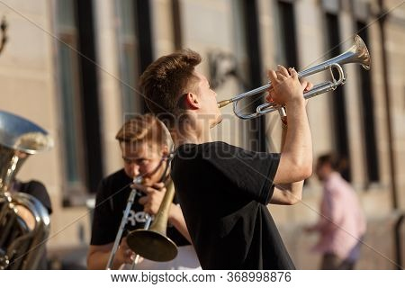 Moscow, Russia, June 02, 2019: Street Musicians With Wind Instruments. Young Guys Playing Trumpet Mu