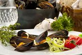 Table with fresh dutch mussels on a plate poster