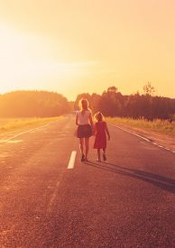 Silhouette Two Little Girls Walking On The Road . Sisters Enjoyed Summer Day Over Blurred Summer Nat