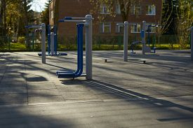Empty Street Exercise Machines In A Public Place. The Concept Of Ban On Walking.