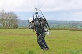 Paramotor Pilot Launching Wing In A Field