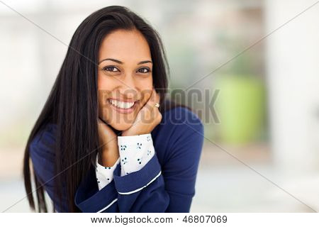 smiling young indian woman in pajamas at home
