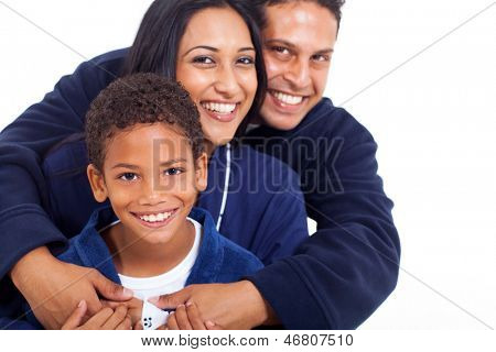portrait of young indian family in pajamas hugging isolated on white
