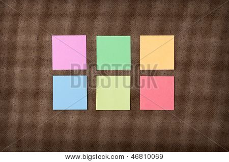 Sticky Notes On Fiberboard Background