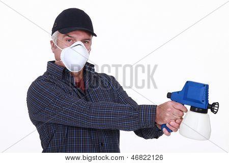 Man with a paint sprayer