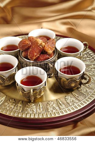 An arabic tea set with dates