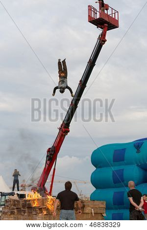 MOSCOW - AUG 25: Man jumping from a height into the burning box on Festival of art and film stunt Prometheus in Tushino on August 25, 2012 in Moscow, Russia. The festival was organized in 1998.