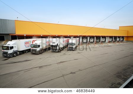 MOSCOW - OCT 16: Trucks loaded in stock in brewery Ochakovo on October 16, 2012 in Moscow, Russia. Ochakovo is largest Russian company beer and soft drinks industry without foreign capital