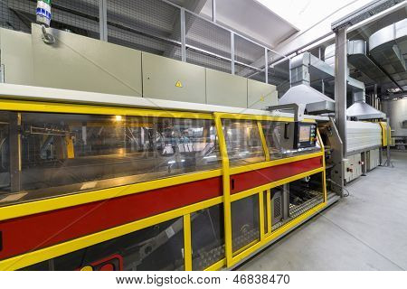 MOSCOW - OCT 16: Packaging machine in brewery Ochakovo on October 16, 2012 in Moscow, Russia. Ochakovo is largest Russian company beer and soft drinks industry without foreign capital