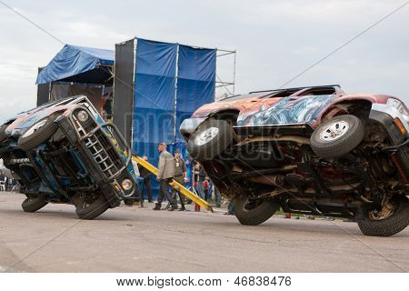 MOSCOW - AUG 25: Cars traveling on two wheels on Festival of art and film stunt Prometheus in Tushino on August 25, 2012 in Moscow, Russia. The festival was organized in 1998.
