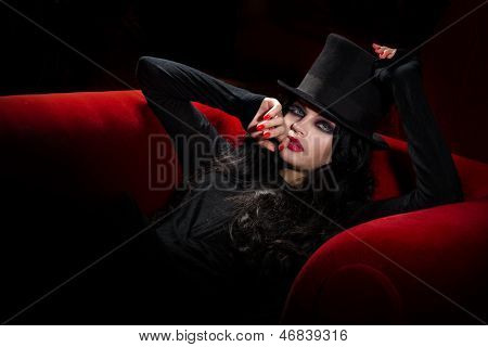 Halloween concept: sexy lady vampire over red background