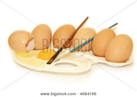 six Eggs on palette spilled with paintbrushes poster