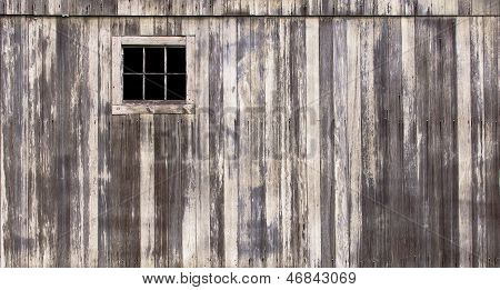 poster of Rustic barn with weathered wood and small window