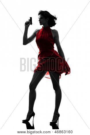 one sexy caucasian woman holding gun in silhouette studio isolated on white background poster