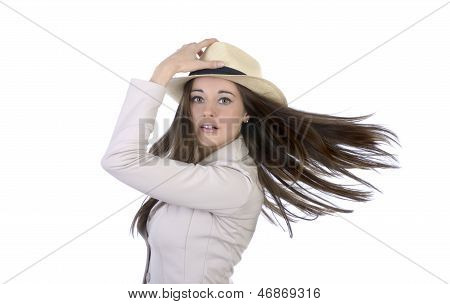 Pretty Elegant Woman With Hat And Flying Hair
