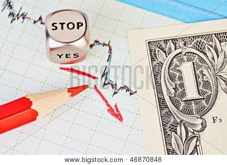 Downtrend Financial Chart, Red Pencil, Red Arrow, Dices Cube With The Word Stop And One-dollar Bankn