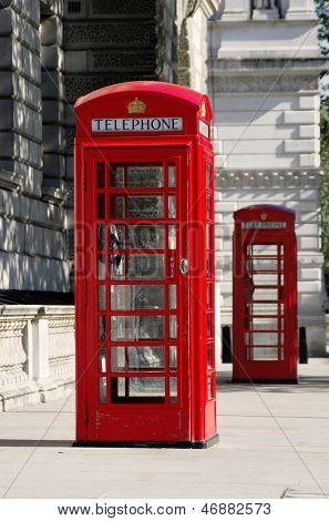two red phone boxes old style in London in row (shallow depth of field)